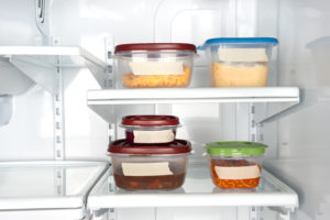 Fridge with food containers and blank labels